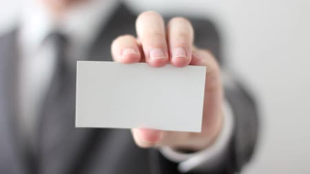 loga : Businessman showing blank business card