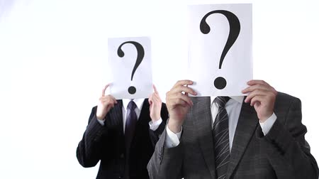 sorular : Business people shaking question mark signs