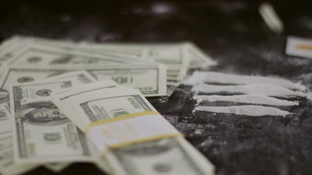 snorting : Cocaine snorted on the table with dollar Stock Footage