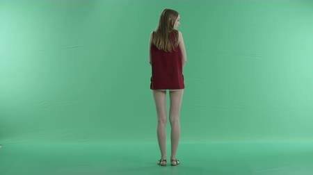 одиноко : beautiful girl waiting for someone on a green screen