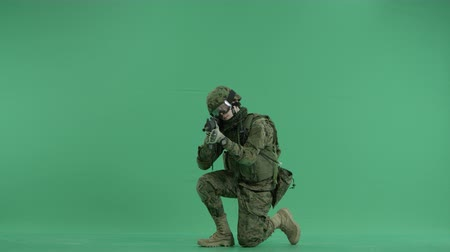 sivil : Soldier sitting and targeting at green screen