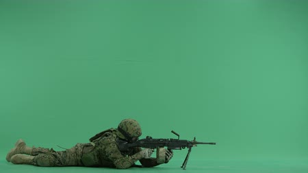 sivil : Soldier lying and targeting to the right at green screen