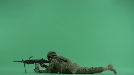donanma : Soldier lying and targeting to the left at green screen