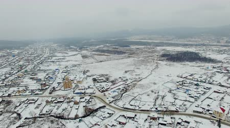 habitação : aerial view of small town and beautiful nature at winter