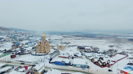 habitação : aerial view of small town and church at winter