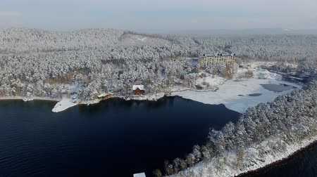 habitação : aerial view settlement at beautiful winter lake and forest