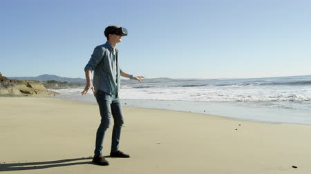 maravilha : Young man walks on the Pacific beach