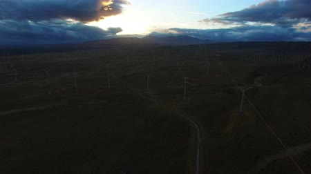 moinho : Bird eye shot of wind turbines in a field at dawn