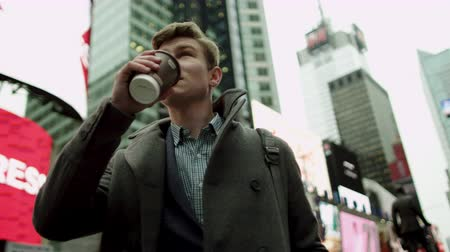 кружка : Walking on Times Square with a cup of coffee