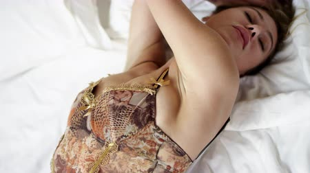 linen : Woman in sexy underwear showing her beautiful fit body while lying on bed