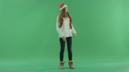 招待状 : Attractive young woman in Christmas hat calls somebody to come, chroma key on background