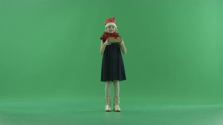 fulllength : Cute little girl in Christmas hat got a nice Xmas present, chroma key on background Stock Footage