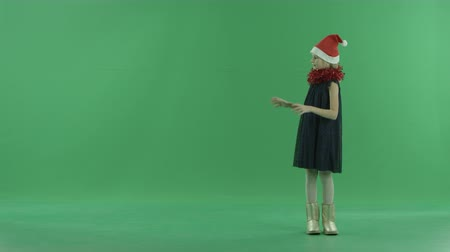 holographic : Cute little girl using virtual screen, chroma key on background Stock Footage