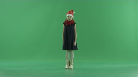 fulllength : Cute little girl in Christmas hat, chroma key on background