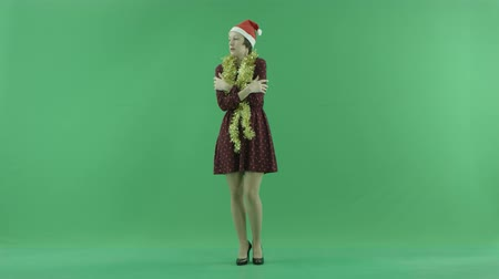bluntly : A young Christmas girl is feeling cold on the green screen