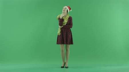 packet : A young Christmas woman is thinking on the green screen Stock Footage