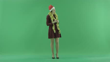 packet : A young Christmas woman calls to someone from the right side on the green screen Stock Footage