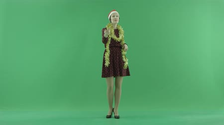 packet : A young Christmas woman calls to the viewer on the green screen Stock Footage