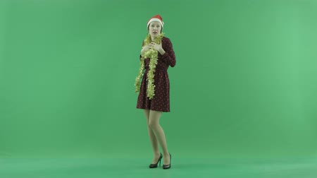 bluntly : A young Christmas woman is showing happiness on the green screen