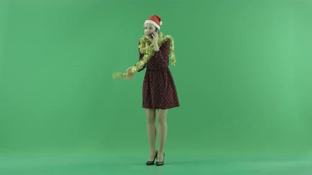 bluntly : A young Christmas woman talking on her phone on the green screen