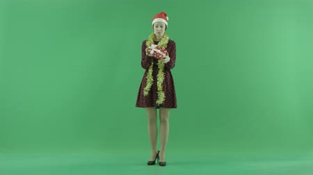 bluntly : A young woman is looking for a Christmas gift on the green screen