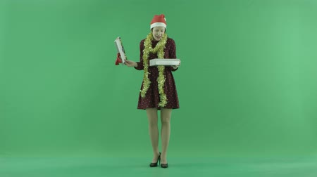bluntly : A young woman is opening the Christmasgift on the green screen Stock Footage