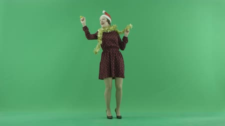 bluntly : A young woman is dancing to the viewer side in the center of the green screen Stock Footage