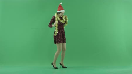 bluntly : A young woman dancing to the right side of the green screen