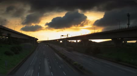 Time lapse of night shot - freeway and car light trails at sunset Stock Footage