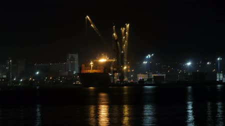 retailer : Container ship discharging at the port at night, port of novorossiysk, 30.10.2018