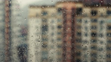 carrancudo : rain drops on windowpane against buildings