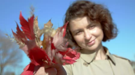 multirracial : Fall bouquet and portrait of happy lovely and beautiful woman on the shore in fall colors.