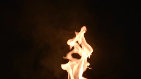 сжигать : Close up of the burning fire on the black background.