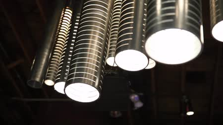 filaman : A group of hanging lights with shallow depth of field. Stok Video