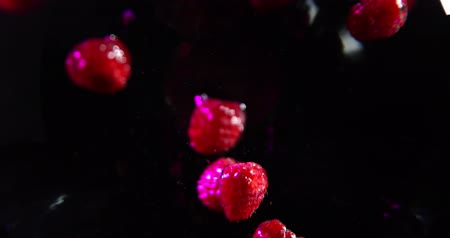 black raspberry : Raspberries falling into a water. black background Stock Footage