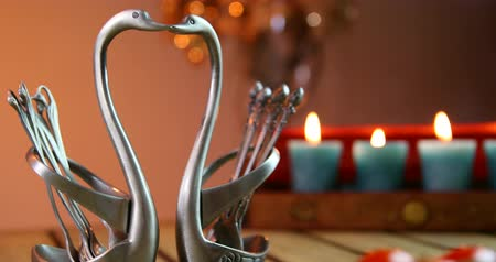 goblet : Romantic candle light dinner. Metal swans.