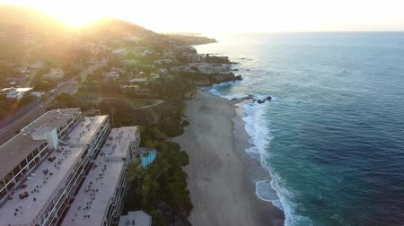 barışçı : California, United States, Aerial view of beach houses along Pacific Coast in California. Real estate during sunset. From above, drone flying over water. Stok Video