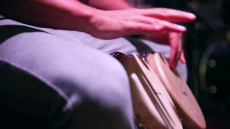 traditional instruments : Drum. Hands of a musician playing on bongs. The musician plays the bongo. Close up of musician hand playing bongos drums. rum, drummer, fingers, hand, hit.