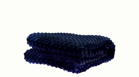 hajtogatott : Blue massaging blanket spinning on the bright white background