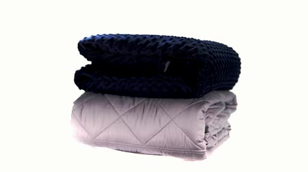 dobrado : Blue and grey massaging blankets spinning on the bright white background