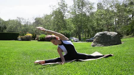the conception : Young blonde woman is doing gymnastic exercises