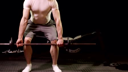 Barbell Deadlift exercise. Studio shot over black. Wideo