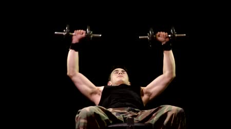 inclinado : Incline dumbbell chest press exercise. Studio shot over black. Stock Footage