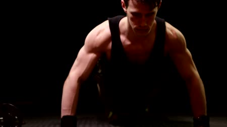 Push up exercise. Studio shot over black. Wideo