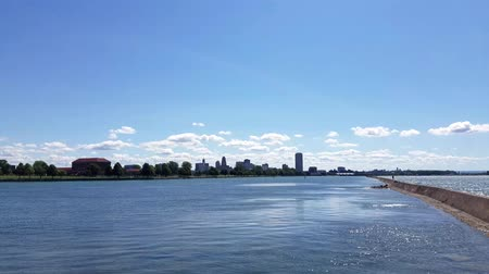 BUFFALO, NEW YORK, USA – August 23, 2016: View of the Buffalo skyline from the break wall separating the Black Rock Canal from the Niagara River.