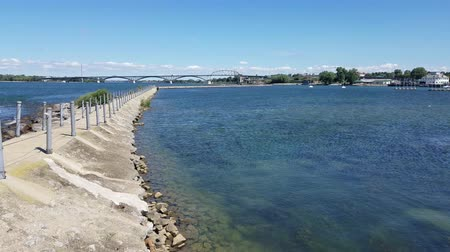 BUFFALO, NEW YORK, USA – August 23, 2016: View of the Peace Bridge on the USACanada border from the break wall separating the Black Rock Canal from the Niagara River.