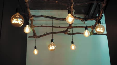 filaman : Large round decorative lamps with filament incandescent hanging on wires tied to wooden frame