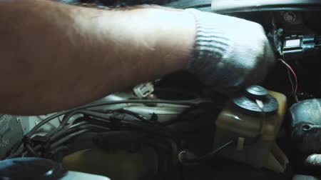 freio : Photo of repair of a running gear of the car mechanics hands