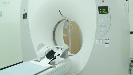 tomograph : Room with white magnetic resonance tomograph for examination of the human body close-up