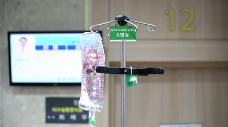 infusion : Transparent drip with medical preporates hanging on the counter close-up